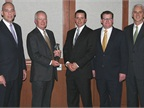 Truckworx Kenworth was named Kenworth's 2012 Parts and Service Dealer of the year for the United States and Canada. From left, are Darrin Silver, Paccar vice president and Paccar general manager; Truckwox Kenworth executives Bob Mitchell and Will Bruser; Tony McQuary, Paccar Parts general sales manager; and Gary Moore, Kenworth general manager and Paccar vice president.