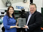 Amy Dobrikova, VP sales and business development, Echo Automotive, accepts ward from Steve Carey, executive director, NTEA.