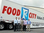 Utility Trailer and Food City officials.