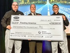 Tom Ondo (left), vice president & general manager, Americas Truck/Trailer/Rail, and Jon Shaw (right), director, Global Communications & Sustainability, Carrier Transicold & Refrigeration Systems, present a $150,000 check to Bill Thomas, chief supply chain officer, Feeding America. Photo: Carrier Transicold