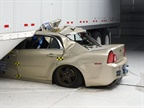 Without a side underride guard, car in 35-mph crash test lodged beneath the semi-trailer. Photo: IIHS