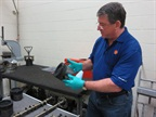 Shell's Dan Arcy explains how oils protect against scuffing or adhesive wear in the cylinders and liners in an earlier engine teardown. (Photo: Deborah Lockridge)