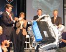 Alabama Gov. Bob Riley, left,  and Navistar and plant officials applaud the unveiling of the new MaxxForce big-bore engine to be built in Huntsville.