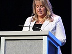 <br />Kari Baylor, vice president, Baylor Trucking, accepts TCA Past Chairmen's Award on behalf of her father. Photo: Jim Beach