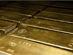 Stock photo of gold bars by Andrzej Barabasz (Chepry) via Wikipedia