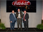 Doug Danylchuk, dealer principal of Peterbilt Manitoba, accepted the