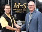 Mike Elliott of M-S Logistics (left) hands the Partner of the Year Award to Bill Sweatman, president of Marangoni Tread N.A. Photo: Marangoni Tread N.A.