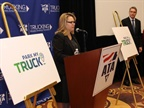 Representatives from the FMCSA, ATA, ATRI and the truck stop group NATSO unveiled a new app designed to help truck drivers find available parking spaces. Photo: Evan Lockridge