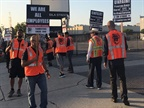 Picketers at XPO Logistics  port operations say port truck drivers
