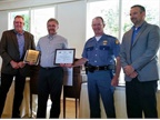 Chris Zondlo, SPD safety coordinator (2nd from left), receives a Great West Safety Award from Great West's Kevin Skow (far left), and the WTA's Safety Fleet of the Year Award from Jason Berry, Washington State Patrol assistant chief (2nd from right) and Tom Walrath, of T.E. Walrath Trucking and WTA president (far right). Photo: Daseke