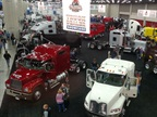 While the truck makers were not at Mid-America this year, there were still quite a few trucks, including in this dealer showcase in the South Hall where the truck makers have traditionally had their booths. Photo by Tom Berg.