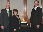 Kari Rihm (center), president and CEO of Rihm Kenworth accepts the award from Gary Moore (left), Kenworth general manager and PACCAR vice president and Preston Feight, Kenworth assistant general manager for sales and marketing.