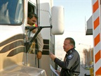An official manually checks a driver s TWIC credentials at the Port of