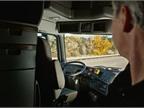 Truck driver monitoring a 120-mile autonomous truck demo trip run in