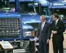 Caption: President George W. Bush is given a tour of Volvo and Mack carbon-dioxide-neutral trucks by Volvo Group CEO Leif Johansson.