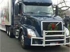 On Saturday, each truck will carry approximately 4,700 wreaths. It takes 52 trucks to deliver 246,000 wreaths to Arlington National Cemetery alone! (Photo courtesy of Omnitracs)