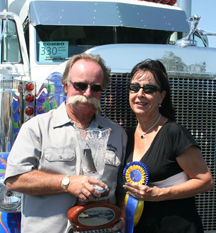 Bill and Marie Sandvik took the top honors in the limited mileage combo class with their 1998 White Peterbilt 379 and 1993 Ravens flatbed.