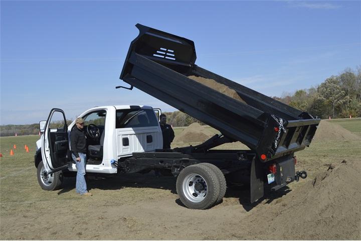 Ram 5500 Dump Truck >> A 2016 Ram 5500 Chassis Regular Cab Tradesman 4X4 with dump bed upfit - Ram Demonstrates Heavy ...