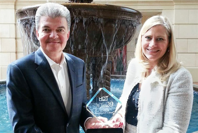 Heavy Duty Trucking Publisher David Moniz presents Top 20 award to J.J. Keller President Marne Keller-Krikava.