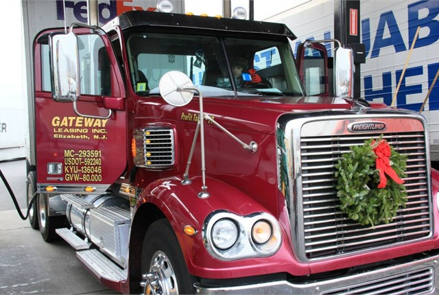 This driver is ready to hit the road with a new, fresh wreath attached to his truck.