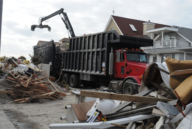 Economists believe come spring, when rebuilding begins in earnest, the storm will benefit trucking, especially the flatbed fleets that will be hauling construction materials into the region.