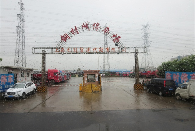 We visited a Chinese truck park on a rainy day.