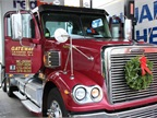 This driver is ready to hit the road with a new, fresh wreath attached to his truck.<br />