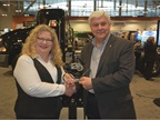 Joseph Scarnecchi, Mack Powertrain sales manager, accepts the HDT Top