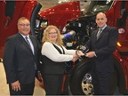 Robert Woodall, Peterbilt assistant general manager, left, and Darrin