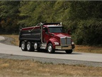 Kenworth T880 dump truck on the winding inner durability track. Photo