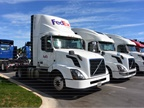 Customers  trucks lined up for service. The FedEx tractor is equipped