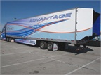 "Kenworth's Advantage tractor-trailer is a working concept vehicle engineered to produce optimum aerodynamics. This photo shows three enhancements to the basic vehicle design: wheel covers, trailer side skirts and an advanced drag reduction device called a ""boat tail"" from ATDynamics. Stacking certain technologies often produces better results, but the total improvement achieved won't necessarily be the sum advertised by the product suppliers."
