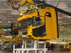 14. At a point where the two assembly lines merge, the cab is hoisted