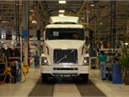 17. A finished truck is ready to drive off the assembly line under its