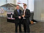 Heavy Duty Trucking Publisher David Moniz, left, presents award to