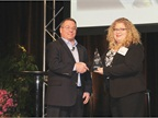 David Hoover accepts his HDT Truck Fleet Innovator award from Editor
