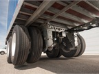 When traveling empty or lightly loaded, the lift axle automatically