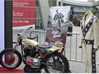 Knievel s iconic motorcycle and leather jumpsuit on the red carpet.