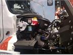 Detroit s new DD8 diesel nestles in a Freightliner 108SD. The