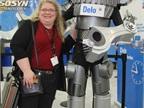 HDT Editor in Chief Deborah Lockridge poses with the Delo Man.