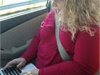 Editor in Chief Deborah Lockridge works in the car on the drive to
