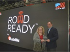 Truck-Lite s Robert Richard, general manager, Road Ready, accepts the