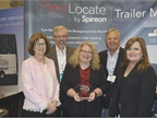 A group from Spireon accepts the HDT Top 20 Products Award from Editor