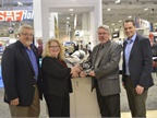 Haldex accepts its Top 20 for the ModulT air disc brake. From left,