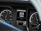 The in-dash display shows that the Highway Pilot Connect system is
