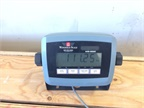 Extremely sensitive scales measure the weight of the fuel left in the