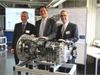 Daimler Trucks officials (from left) Ehrhard Thiel, manager for