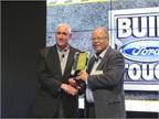 Work Truck Editor Mike Antich presents John Ruppert, General Manager