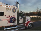 One of the trucks from Arpin Van Lines that helped deliver wreaths to