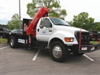 Odyne plug-in hybrid electric with hydraulic crane on a Ford F750 chassis.